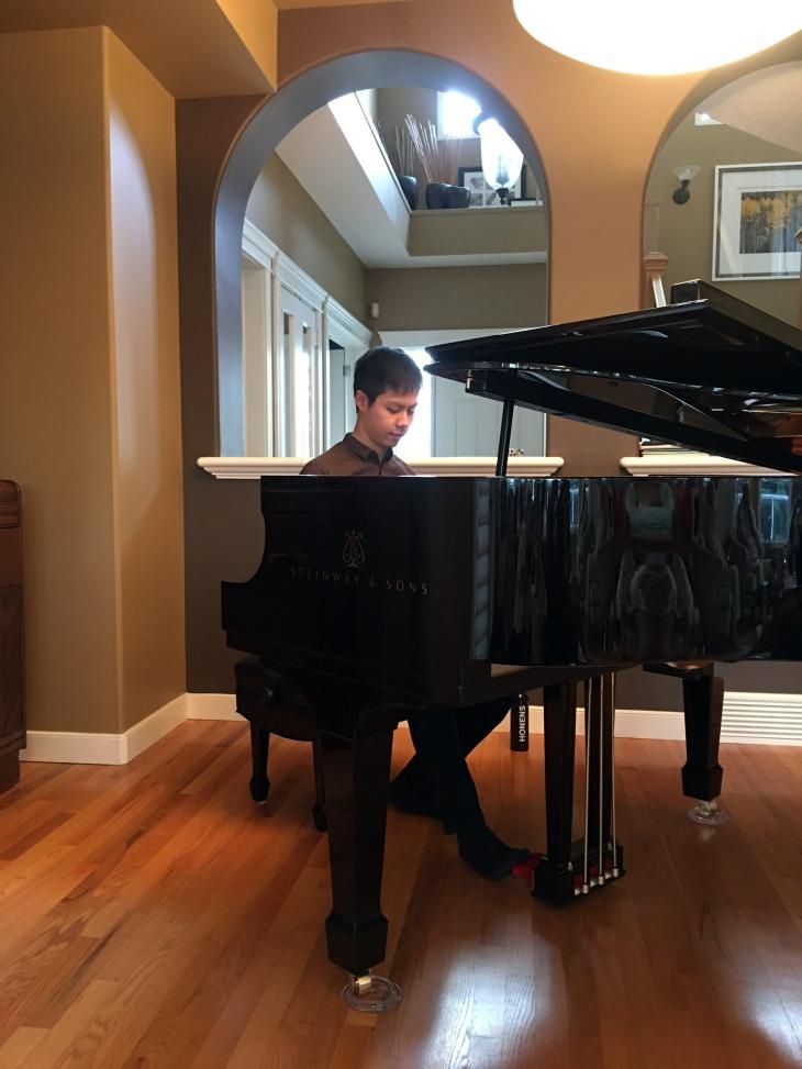 Han Chen playing Piano